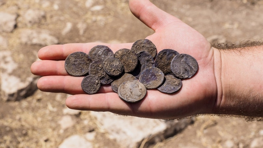 The cache of silver coins found at the estate house. (Photographic credit: Assaf Peretz, courtesy of the Israel Antiquities Authority)