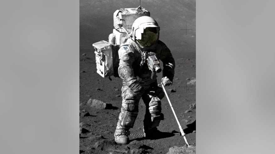 "Astronaut-geologist Harrison Schmitt on an Apollo 17 moonwalk in 1972. The cohesive nature of the lunar soil is borne out by the ""dirty"" sheen of his space suit, later tracked into the nearby lunar m"