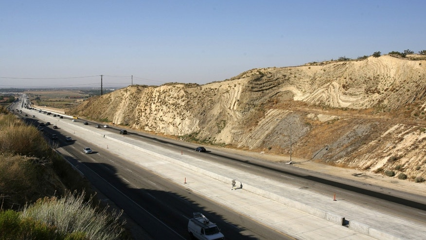 California's Antelope Valley freeway passes near folded layers of sediment above the San Andreas Fault near Palmdale, California June 22, 2006.