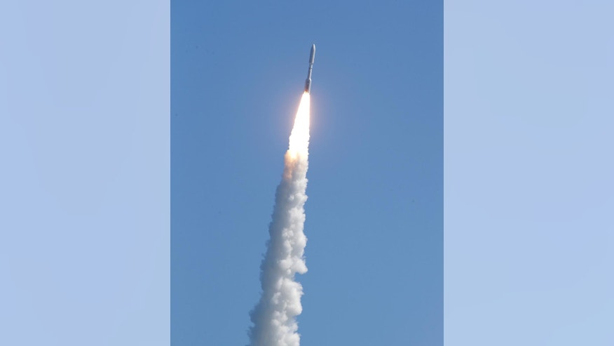A United Launch Alliance Atlas V rocket carrying a U.S. Navy communications satellite lifts off from Complex 41 at the Cape Canaveral Air Force Station, Friday, June 24, 2016, in Cape Canaveral, Fla. The satellite is designed to significantly improve ground communications for U.S. forces on the move. (AP Photo/John Raoux)