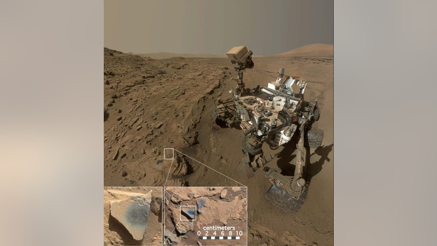"This photo shows NASA's Mars rover Curiosity at a location called ""Windjana,"" where the rover found rocks containing manganese-oxide minerals, which require abundant water and strongly oxidizing conditions"