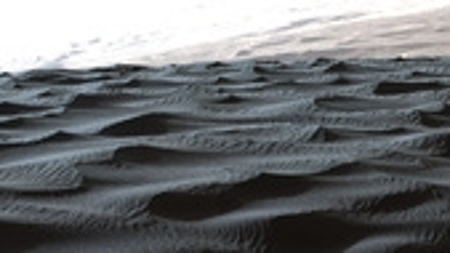 This photo by NASA's Mars rover Curiosity shows large wind ripples with superimposed small ripples on the Namib Dune of the Bagnold Dune Field inside Gale Crater.