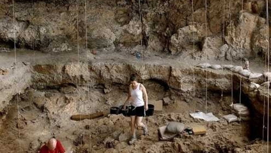 Hebrew University archaeologists uncovered a 12,000 year old grave inside a cave in northern Israel.