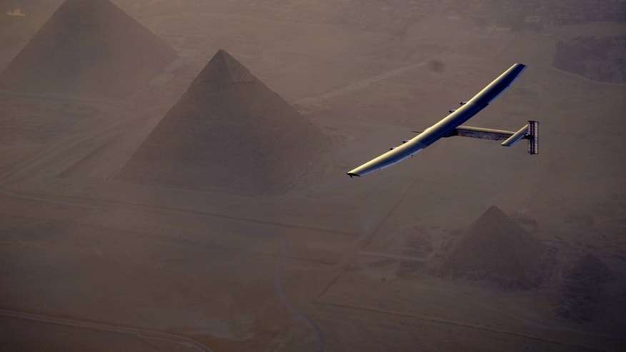 In this Wednesday, July 13, 2016, handout image provided by Solar Impulse, the Solar Impulse 2 flying over the pyramids, Egypt Cairo. The experimental solar-powered airplane has arrived in Egypt as part of its global voyage.