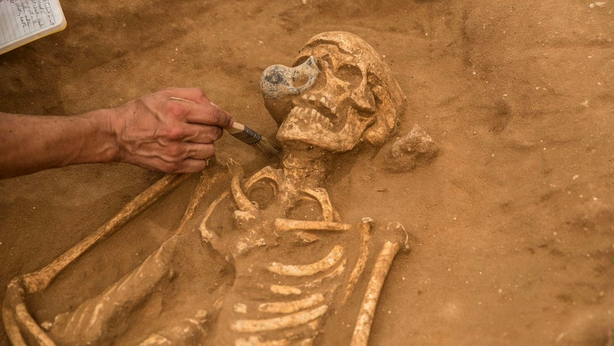 One of the skeletons found in the possible Philistine cemetery in Ashkelon, Israel, had a juglet stuck to its skull.