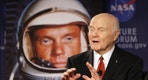 """FILE - In this Feb. 20, 2012, file photo, U.S. Sen. John Glenn talks with astronauts on the International Space Station via satellite before a discussion titled """"Learning from the Past to Innovate for the Future"""" in Columbus, Ohio. The 94-year-old former U.S. senator and his wife are scheduled to appear at a ceremony Tuesday, June 28, 2016, to rename Port Columbus International Airport in Ohio's capital city as John Glenn Columbus International Airport. (AP Photo/Jay LaPrete, File)"""