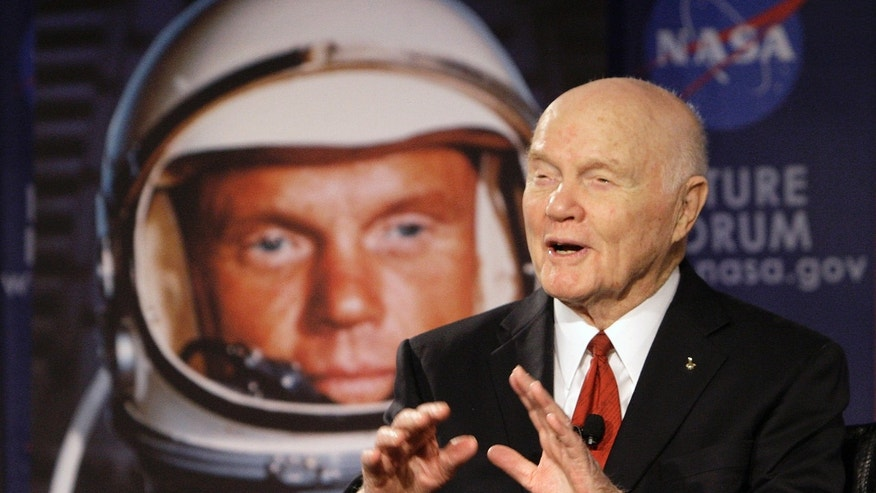 "FILE - In this Feb. 20, 2012, file photo, U.S. Sen. John Glenn talks with astronauts on the International Space Station via satellite before a discussion titled ""Learning from the Past to Innovate for the Future"" in Columbus, Ohio.  (AP Photo/Jay LaPrete, File)"