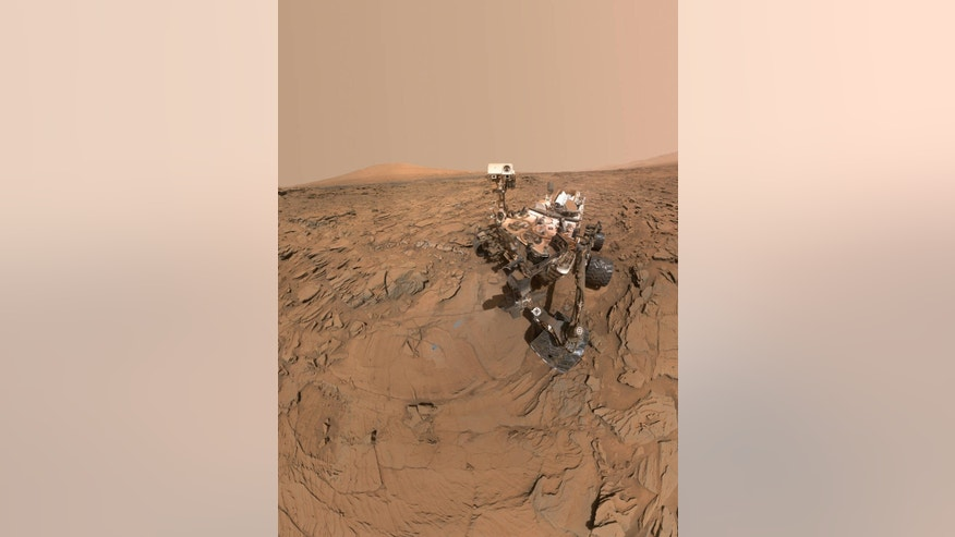 """This selfie of NASA's Curiosity Mars rover shows the vehicle at a drilled sample site called """"Okoruso,"""" on the """"Naukluft Plateau"""" of lower Mount Sharp. The scene combines several images taken with the rover's Mars Hand Lens Imager (MAHLI) on May 11, 2016, during the 1,338th Martian day, or sol, of the rover's work on the Red Planet."""