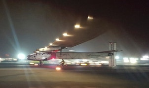 The Solar Impulse 2 plane lands in an airport in Abu Dhabi, United Arab Emirates, early Tuesday, July 26, 2016, marking the historic end of the first attempt to fly around the world without a drop of fuel, powered solely by the sun's energy. The epic 22,000-mile (35,000km) journey began more than a year ago in the same spot where it landed at the Al Bateen Executive Airport.  The Swiss-engineered Si2 has made 16 stops across the world to demonstrate that using the plane's clean technologies on the ground can save natural resources and improve quality of life. (AP Photo/Aya Batrawy)