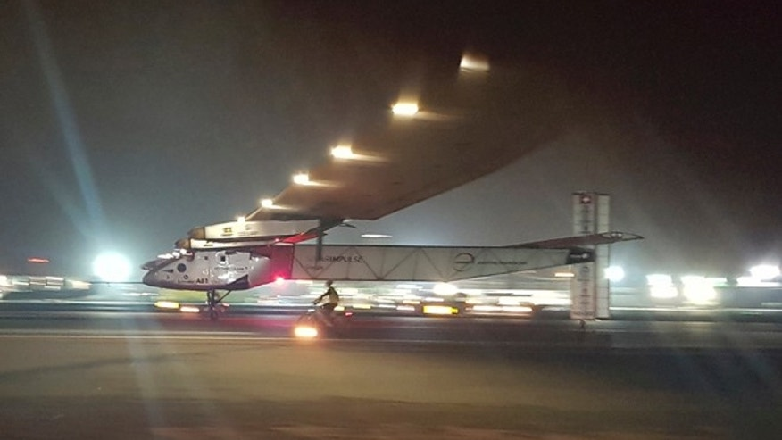 The Solar Impulse 2 plane lands in an airport in Abu Dhabi, United Arab Emirates, early Tuesday, July 26, 2016, marking the historic end of the first attempt to fly around the world without a drop of fuel, powered solely by the sun's energy. (AP Photo/Aya Batrawy)