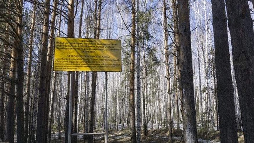 A sign warns people not to enter the town of Ozersk.