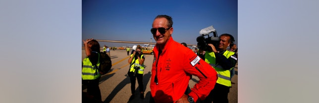 Swiss aviator Andre Borschberg looks on at journalists and media after the solar powered plane Solar Impulse 2 landing at Cairo Airport, Egypt July 13, 2016. REUTERS/Amr Abdallah Dalsh - RTSHT7P