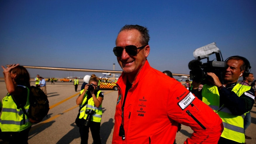 File photo - Swiss aviator Andre Borschberg looks on at journalists and media after the solar powered plane Solar Impulse 2 landing at Cairo Airport, Egypt July 13, 2016. (REUTERS/Amr Abdallah Dalsh)