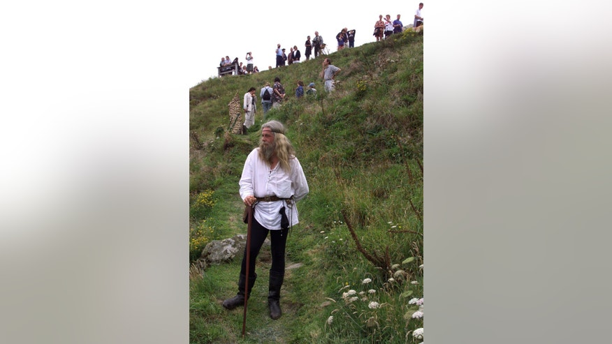 "File photo - Local King Arthur fanatic David Strutt, who likes to be known as Gandalf, stands at the sight where archaeologists found a sixth century slate inscribed with the name ""Artognov"" at Tintagel Castle August 6, 1998."