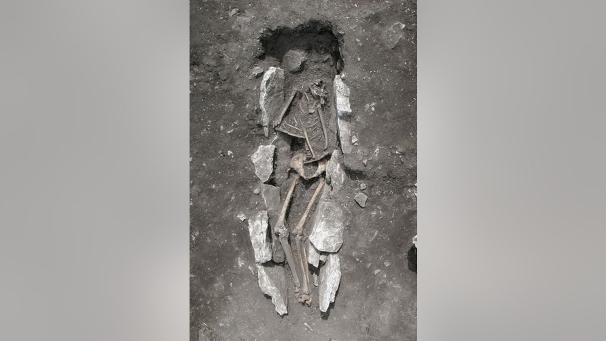 The 3,000-year-old skeletal remains of a teenage male were found buried at an altar used for sacrifice on Mount Lykaion. Part of the skeleton's skull is missing, according to archaeologists.