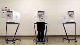 """A voter is seen at a polling station during the New York primary elections in the Manhattan borough of New York City, U.S., April 19, 2016. Nearly half of Americans believe that the system that U.S. political parties use to pick their candidates for the White House is """"rigged"""" and two-thirds want to see the process changed, according to a Reuters/Ipsos poll. REUTERS/Brendan McDermid/File Photo - RTX2BUJM"""