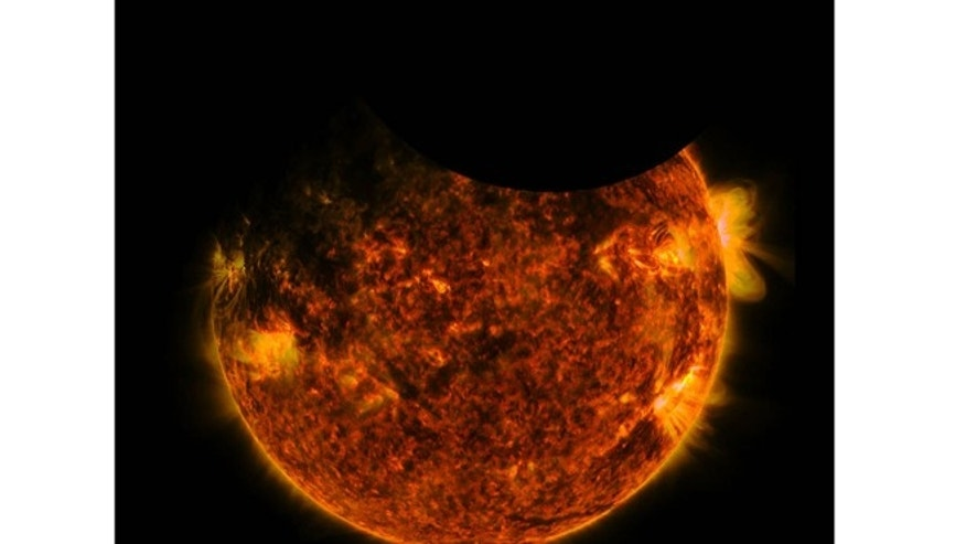 Early Friday, NASA's Solar Dynamics Observatory caught both Earth and the moon passing in front of the sun. (NASA)