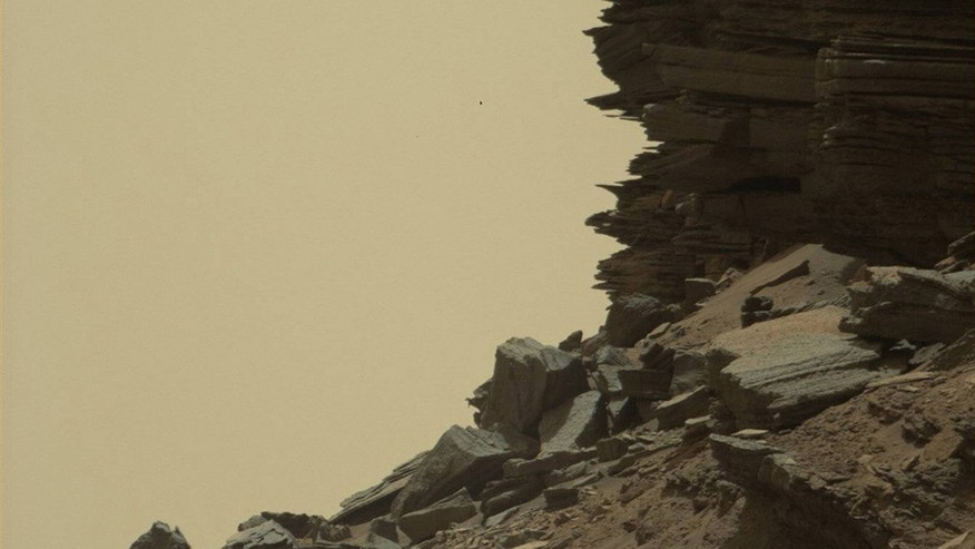 Sept. 8, 2016: This image take by the Mars Curiosity Rover shows a dramatic hillside outcrop with sandstone layers.