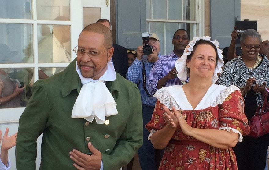 In this photo taken June 25, 2016, Craig Syphax, of Arlington, Va. and Donna Kunkel of Los Angeles, portray their ancestors at a re-enactment of the 1821 wedding of slaves Charles Syphax and Maria Carter at Arlington House, the estate once owned by George Washington's adopted son, George Washington Parke Custis, in Arlington, Va. The re-enactment included an acknowledgement by the National Park Service that Carter was the daughter of Custis and a Mount Vernon slave, Arianna Carter. (AP Photo/Matthew Barakat)