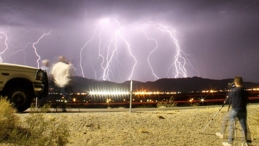 File photo: Southern California storm chasing photographers take pictures of the mass lightning bolts lighting up night skies from monsoon storms passing over the high deserts, early Wednesday north of Barstow, California, July 1, 2015. Picture taken using long exposure. (REUTERS/Gene Blevins)