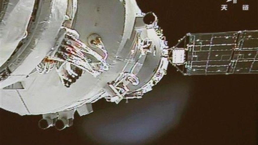 The Shenzhou-9 spacecraft docks with the Tiangong-1 space lab in 2012. The lab is currently falling back to Earth and is scheduled to burn up in the atmosphere sometime in the second half of 2017.