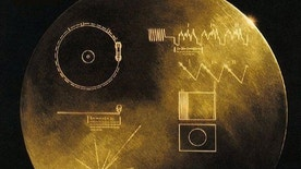 "This undated handout image provided by NASA shows a message carrying Golden Record that Voyager carried, a phonograph record-a 12-inch gold-plated copper disk containing sounds and images selected to portray the diversity of life and culture on Earth. Astronomers have their own cosmic version of the single person's Valentine's Day dilemma: Do you wait for that interesting person to call you or do you make the call yourself and risk getting shot down. Their version involves E.T. Instead of  love, astronomers are looking for life out there in the universe. For decades, astronomers have sat by their telescopes, listened and waited for a call from E.T. only to be left alone. So now some of them want to aim their best radars and lasers out to the sky to say ""We're here, call us"" to the closest few thousand worlds. They can bring us all sorts of new technologies and answers to burning questions, some hope. (AP Photo/NASA)"