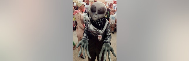 Crystal Graham, wearing an extra-terrestrial costume, waits in line for her turn in the UFO costume contest in Roswell, July 3. Roswell, the site of an alleged UFO crash in 1947, is hosting an international UFO conference which includes family events like the costume contest. ake/DIGITAL/Photo by J.UFO - RTR53NO