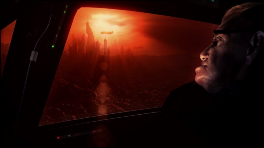 """Astrophysicist Stephen Hawking views a CGI alien civilization on the exoplanet Gliese 832c in this still from the new documentary """"Stephen Hawking's Favorite Places."""""""