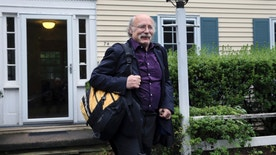Princeton University physics professor F. Duncan Haldane leaves his home after it was announced that he has been awarded the 2016 Nobel Prize in Physics early Tuesday, Oct. 4, 2016, in Princeton, N.J. Haldane shares the award with fellow scientists David Thouless and Michael Kosterlitz.  (AP Photo/Mel Evans)