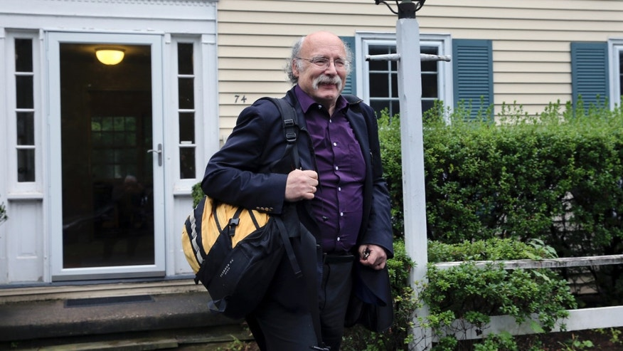 Princeton University physics professor F. Duncan Haldane leaves his home after it was announced that he has been awarded the 2016 Nobel Prize in Physics early Tuesday, Oct. 4, 2016, in Princeton, N.J. Haldane shares the award with fellow scientists David Thouless and Michael Kosterlitz.