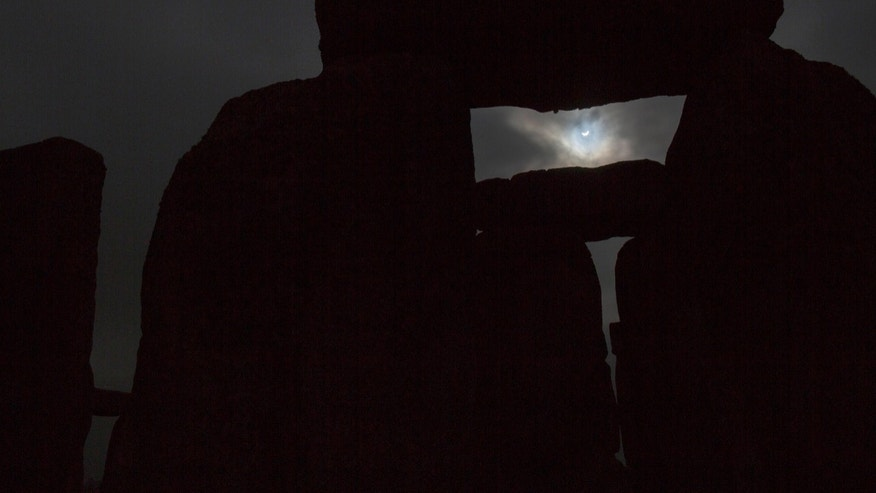 File photo: The solar eclipse is seen over Stonehenge on Salisbury Plain, Salisbury, southern England March 20, 2015. (REUTERS/Kieran Doherty)