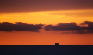 A ship is seen on the horizon of the Atlantic ocean, in Havana August 29, 2011. REUTERS/Desmond Boylan (CUBA - Tags: MARITIME SOCIETY TPX IMAGES OF THE DAY) - RTR2QINX