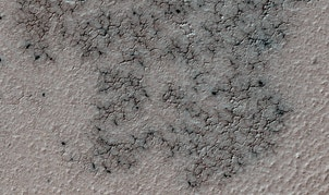 """""""Spidery"""" channels spotted near Mars' south pole by NASA's Mars Reconnaissance Orbiter."""