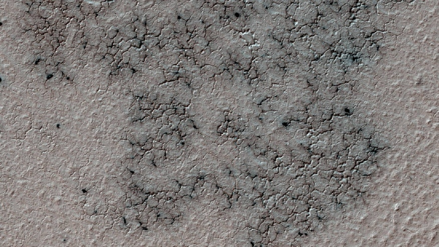 """Spidery"" channels spotted near Mars' south pole by NASA's Mars Reconnaissance Orbiter."