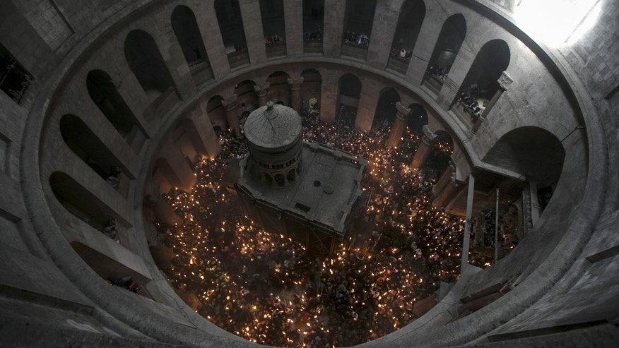 File photo - Worshippers hold candles as they take part in the Christian Orthodox Holy Fire ceremony aound the Edicule at the Church of the Holy Sepulchre in Jerusalem's Old City April 11, 2015. (REUTERS/Baz Ratner)