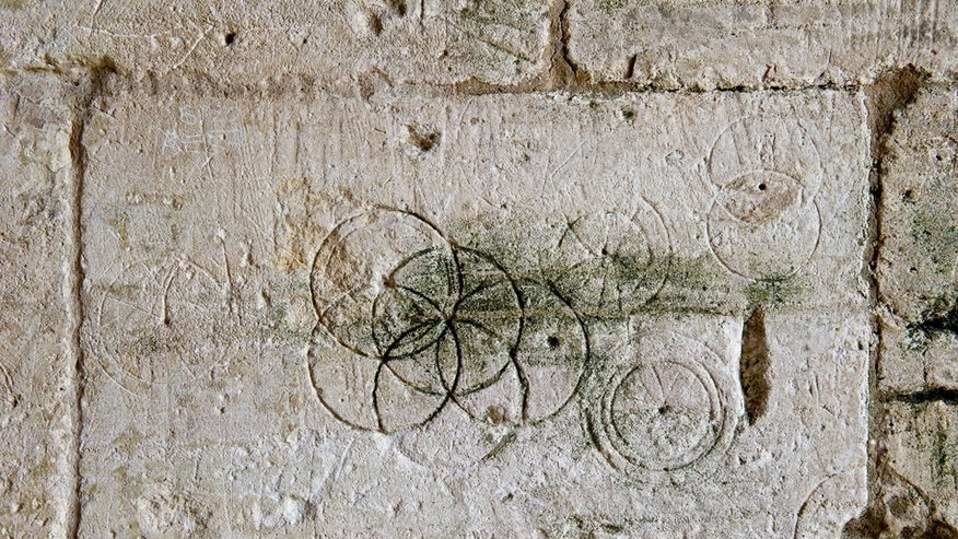 Daisy-Wheels inscribed with a pair of compasses or dividers found in Saxon Tithe barn, Bradford-on-Avon (Historic England).