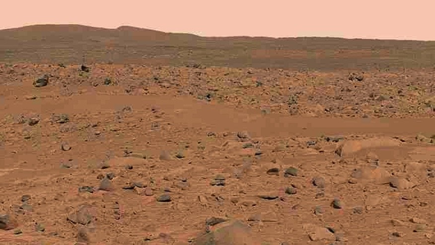 "This image, cropped from a larger panoramic image mosaic taken by the Mars Exploration Rover Spirit panoramic camera, released by NASA March 18, 2004, shows the rover's destination toward the hills nicknamed the ""Columbia Hills."" (REUTERS/NASA/JPLCornell/USGS)"