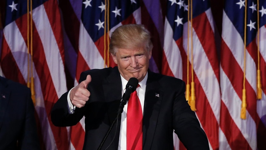 File photo - U.S. President-elect Donald Trump greets supporters during his election night rally in Manhattan, New York, U.S., November 9, 2016. (REUTERS/Mike Segar)