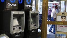 JPMorgan Chase ATMs stand near a door as customers walk past a Duane Reade store in New York, U.S., October 3, 2016.  REUTERS/Lucas Jackson  - RTSQM1D