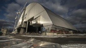 In this Monday, Nov. 14, 2016 photo an arch-shaped shelter, in Chernobyl, Ukraine, has begun creeping toward the exploded Chernobyl nuclear reactor in what represents a significant step toward liquidating the remains of the world's worst nuclear accident.