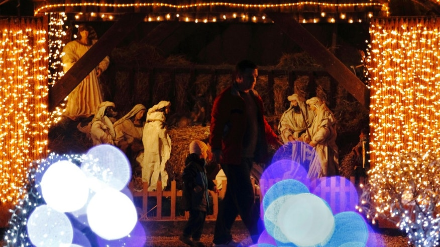 File photo - a lit up nativity scene is seen at a country house estate in the village of Grabovnica near Cazma, central Croatia, Dec. 10, 2011. (REUTERS/Nikola Solic)