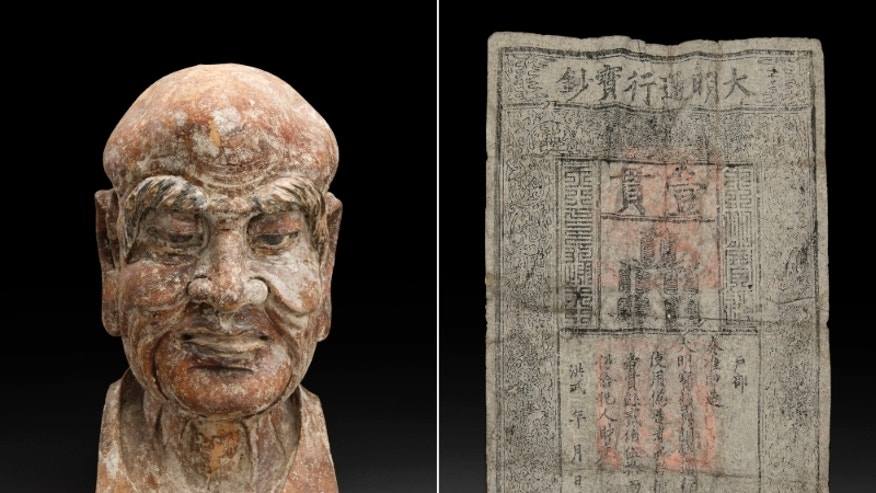 The rare Ming Dynasty paper banknote was hidden in the wooden sculpture of a Chinese religious figure more than 600 years ago.