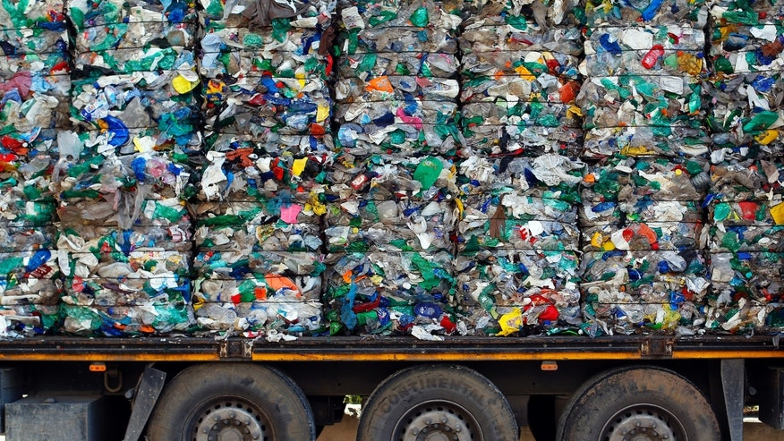 File photo: A truck loaded with waste is seen at the Malagrotta landfill near Rome, December 11, 2013.