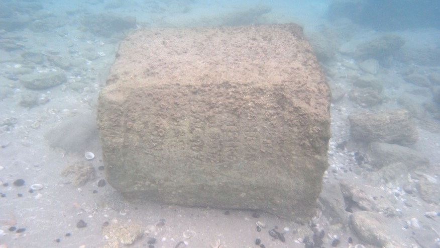 The stone slab, dating to the second century, was found underwater at Tel Dor, south of the city of Haifa.