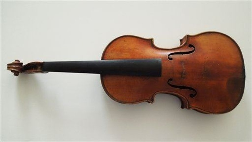 File photo of the Ames Stradivarius stolen from violinist Roman Totenberg in 1980. It was returned in 2015.   (FBI via AP)