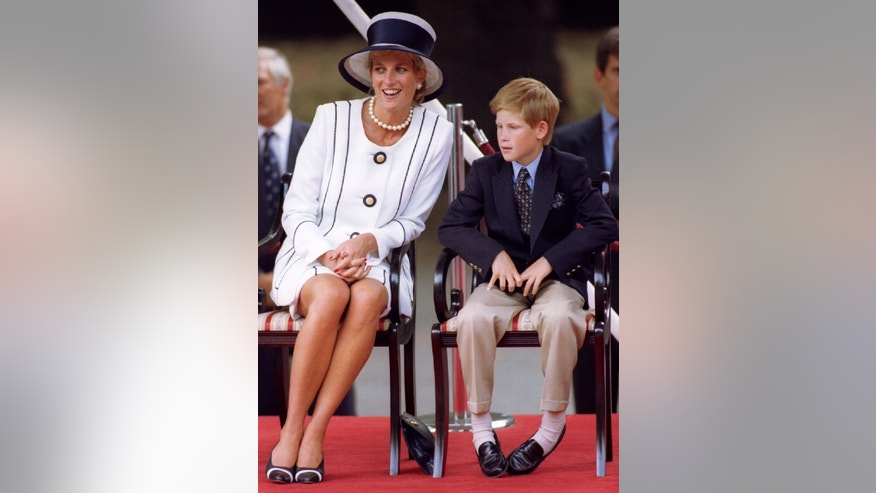 File photo - The Princess of Wales and Prince Harry attend VJ (Victory over Japan) Day ceremonies in the Mall Aug. 19, 1995. (Reuters).