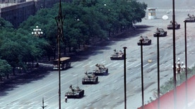 A man stands passively to block a column of army tanks on Changan Avenue east of Tiananmen Square in Beijing in this June 5, 1989 file photo.The tanks did not slow down, but they did turn around him before taking up position in another part of the city. Tanks rolled into the square before dawn on June 4, 1989, to crush a pro-democracy movement. The ruling Communist Party has never released a death toll and fears any public marking of the crackdown could undermine its hold on power. REUTERS/Arthur Tsang/Files (CHINA ANNIVERSARY CONFLICT MILITARY POLITICS) - RTR2499A