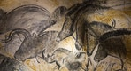 A replica of pre-historic drawings showing horses, rhinoceros and aurochs is seen on a wall during a press visit at the site of the Cavern of Pont-d'Arc project in Vallon Pont d'Arc April 8, 2015. The Cavern of Pont-d'Arc project is a replica of the pre-historic Decorated Cave of Pont-d'Arc known as Grotte Chauvet, in Vallon Pont-d'Arc in the Ardeche region, containing the world's earliest known art which was recently named a UNESCO World Heritage site. The facsimile cavern, which condenses some 8000m2 of the original site into 3000m2, will display faithful reproductions of paintings and engravings and will be inaugurated on April 10 and will open to the public on April 25.   REUTERS/Robert Pratta - RTR4WJ9E