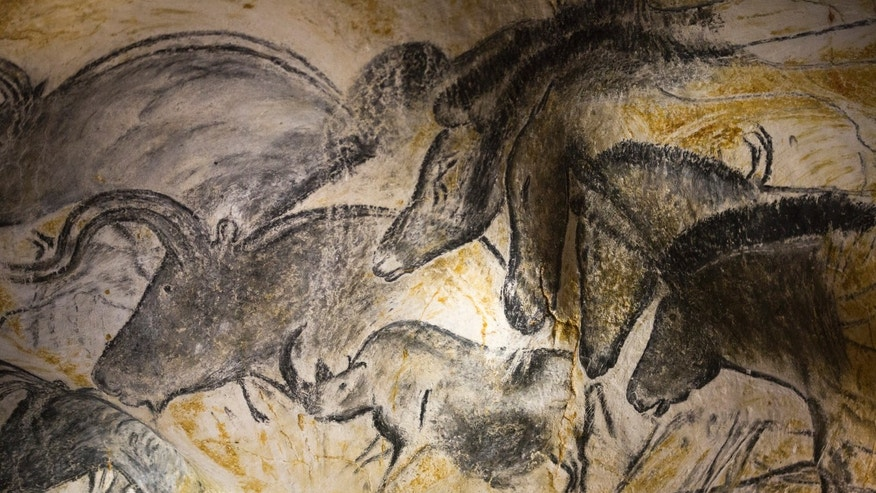 File photo - A replica of pre-historic drawings showing horses, rhinoceros and aurochs is seen on a wall during a press visit at the site of the Cavern of Pont-d'Arc project in Vallon Pont d'Arc April 8, 2015. (REUTERS/Robert Pratta)