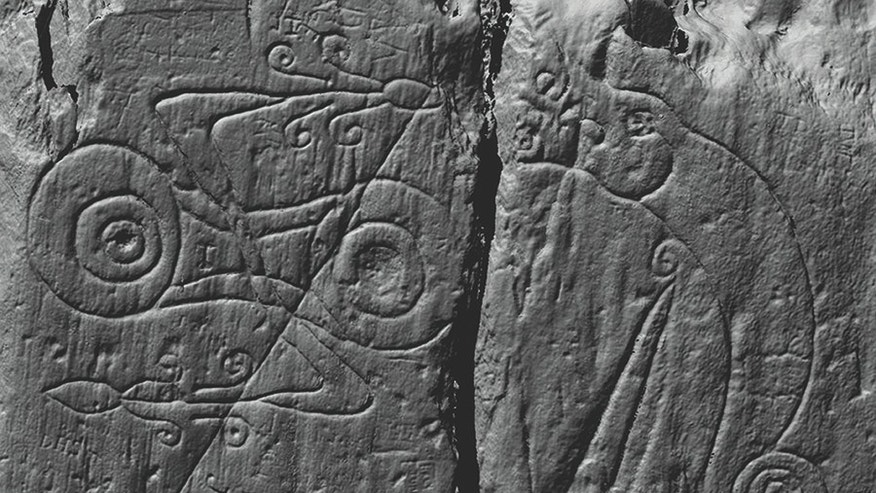 A laser scan image of the Pictish symbols carved at Trusty's Hill, comprising a z-rod-and-double-disc symbol on the left and a dragon-pierced-by-a-sword symbol on the right (© DGNHAS/CDDV).